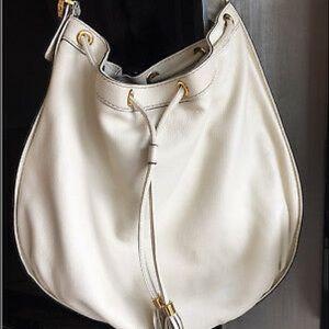 Authentic Gucci drawstring bag, cream color